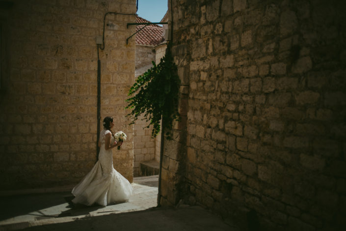 Bride walks through the backstreets of Hvar