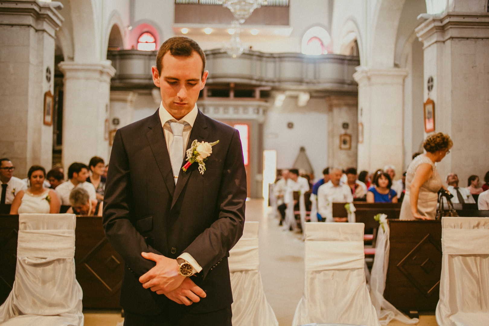 Groom nervously waits for his bride to arrive