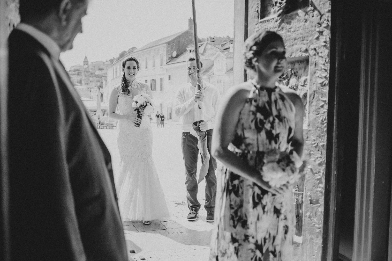 Bride getting ready to enter the St. Stephen's church on Hvar island
