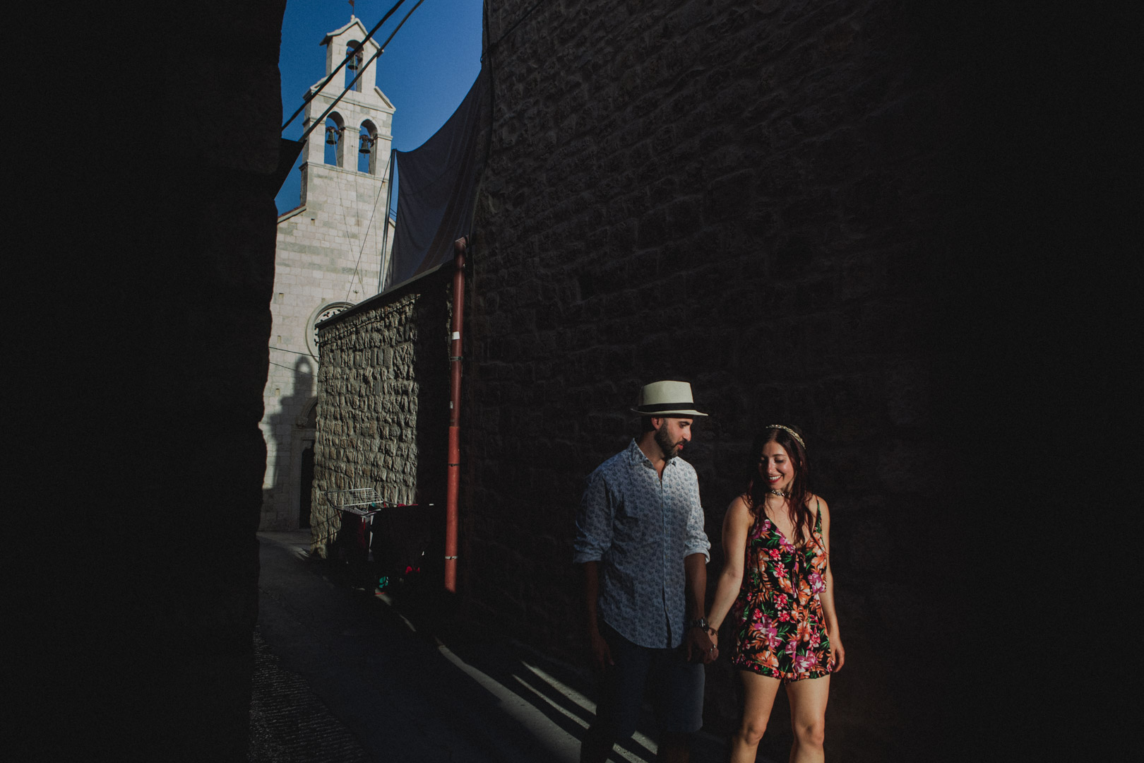 Couple walking through streets of Hvar after getting engaged