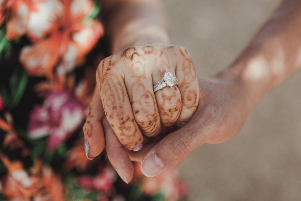 Engagement ring on lady hand with henna tattoo